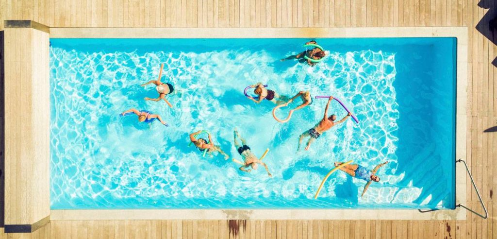 Top view of group of seniors doing water gymnastics in pool - PNPF00105