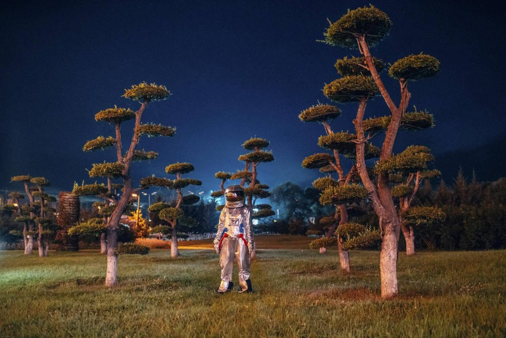 Spaceman standing in a park at night - VPIF00744