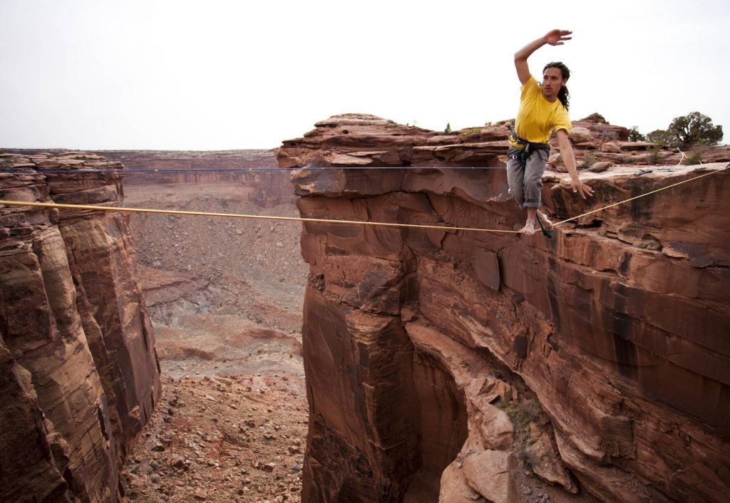 Highlining at the Fruit Bowl in Moab, Utah. - AURF00904