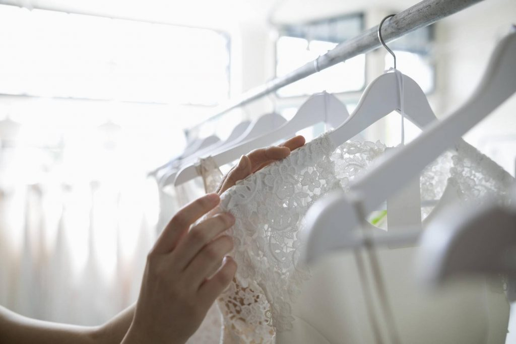 Bride shopping for wedding dresses in bridal boutique - HEROF15192