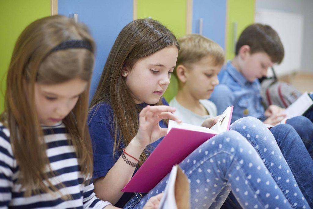 Pupils learning together on corridor in school - ABIF00390