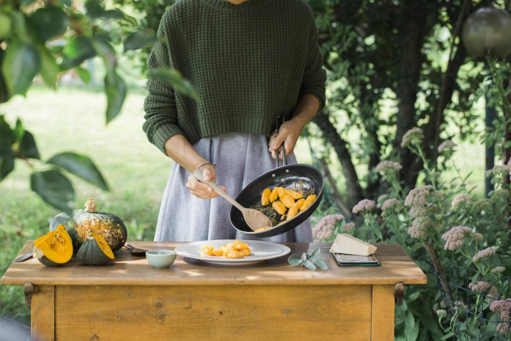 Young woman with homemade pumpkin gnocchi, partial view - ALBF00615