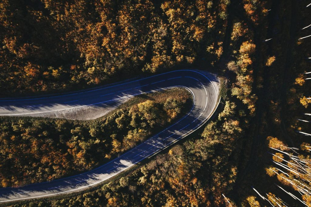Austria, Lower Austria, Vienna Woods, Exelberg, aerial view on a sunny autumn day over a winding mountainroad - HMEF00109