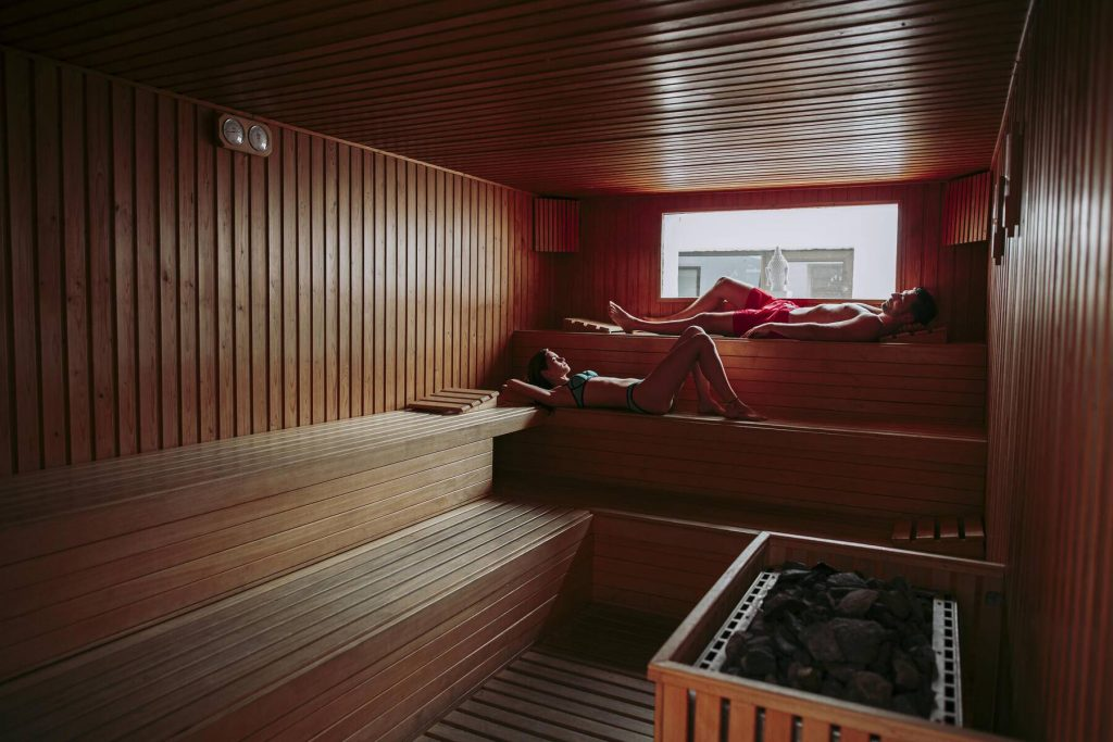 Couple relaxing in a sauna - Couple relaxing in a sauna