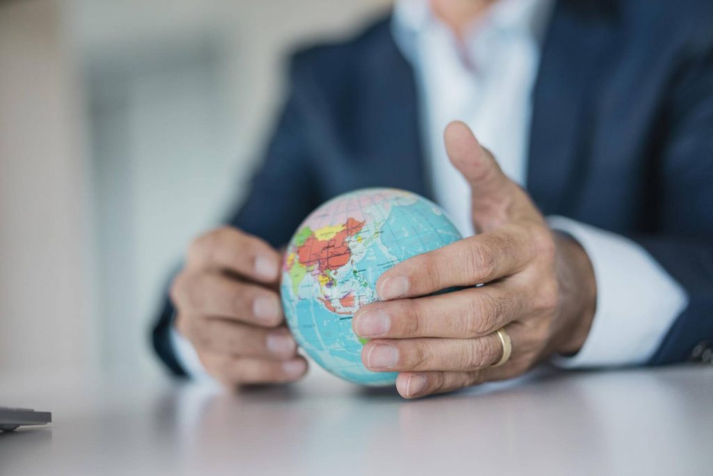 JOSF01830 - Close-up of hands of businessman holding globe