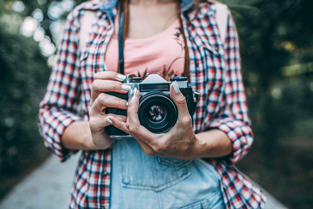 Close-up of woman with a camera   - VPIF00153