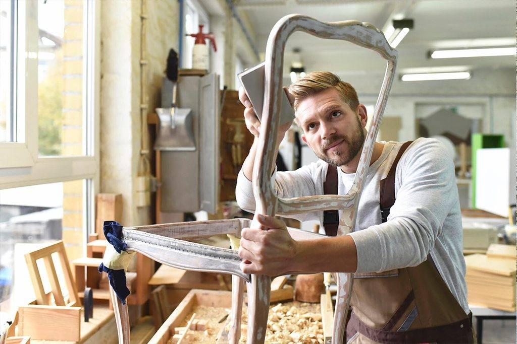 Carpenter restoring a wooden chair   - LYF00680