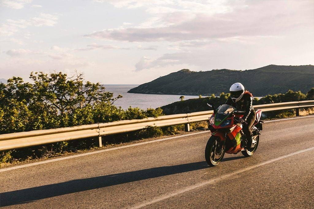 Italy, Elba island, female motorcyclist biking - FBAF00226