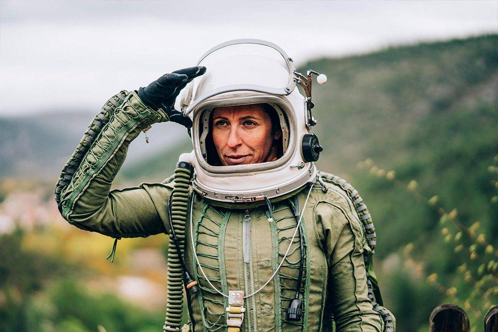 Portrait of woman in space suit exploring nature - OCMF00086