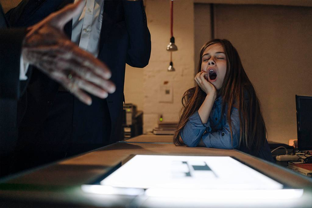 Businessman and yawning girl with shining tablet in office - GUSF02915