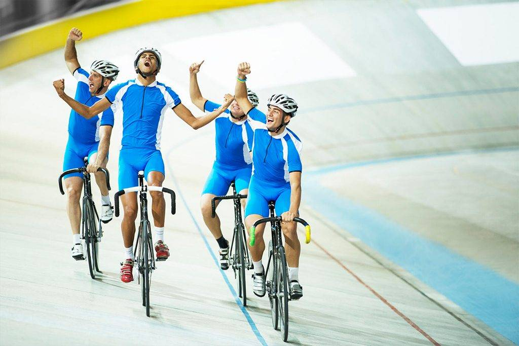 Track cycling team celebrating on track -CAIF14178