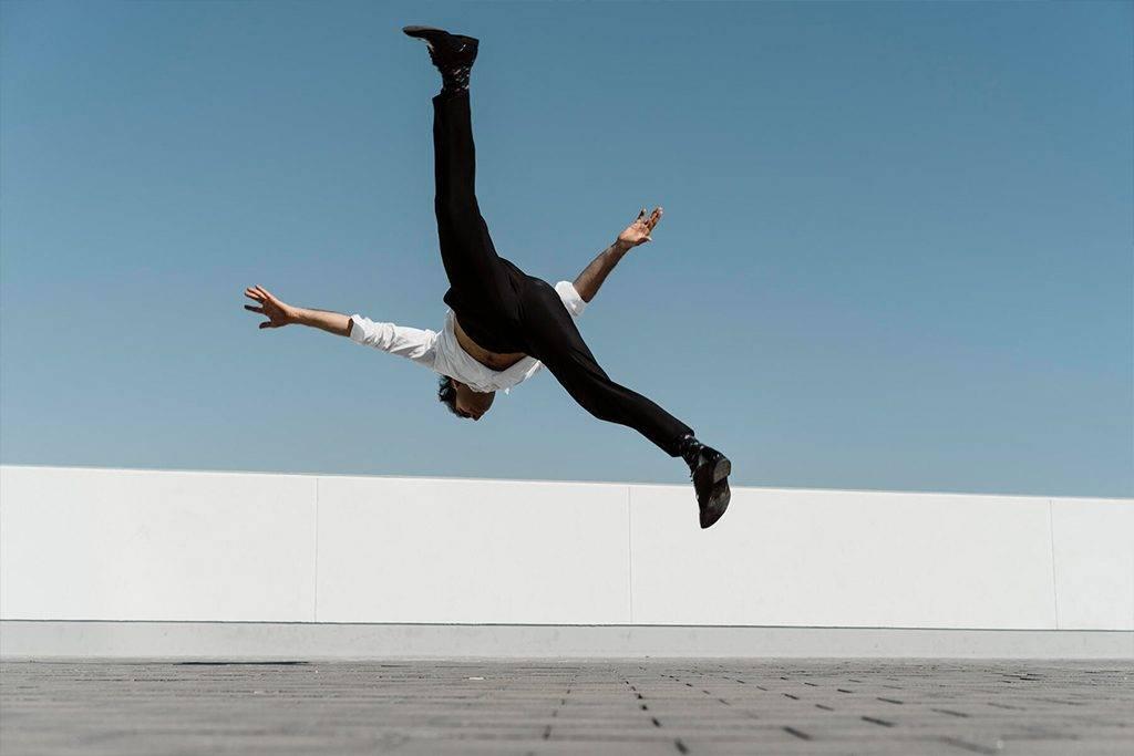 Artist practising on roof terrace - AFVF02661