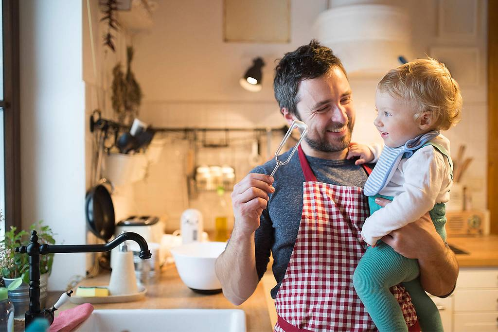 Father and baby boy in kitchen baking a cake - HAPF01336