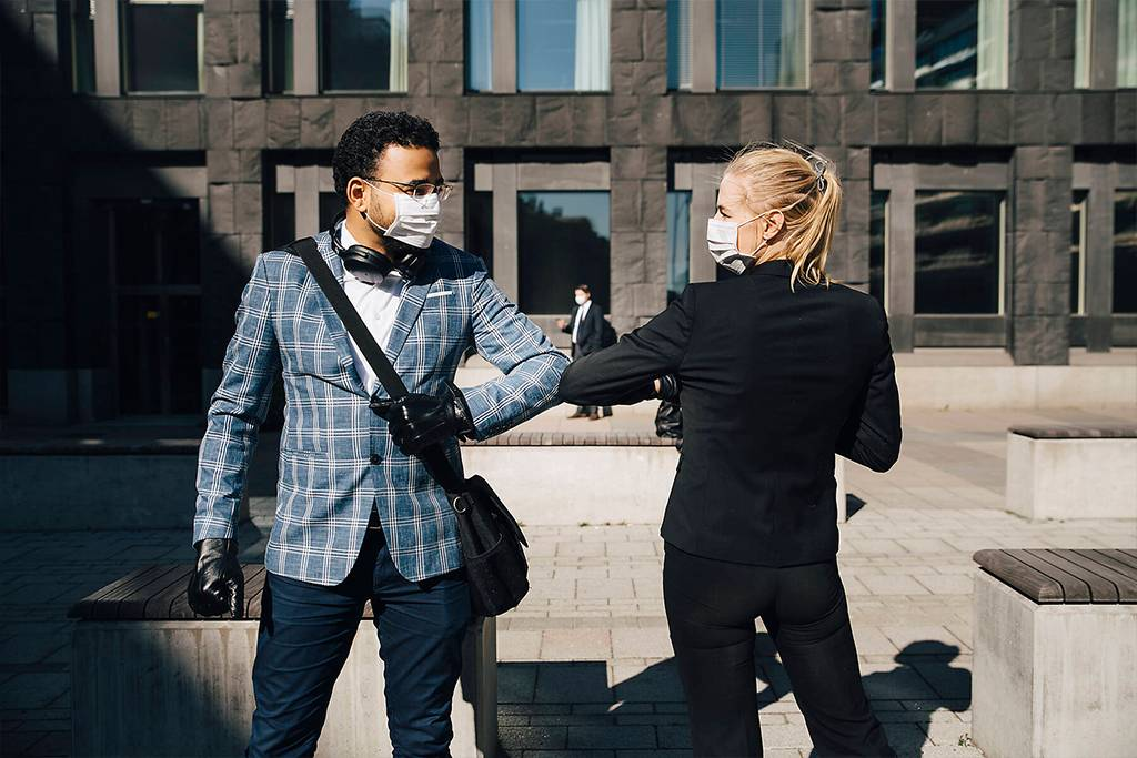 Business people using elbow greeting during covid-19 pandemic - MASF17355