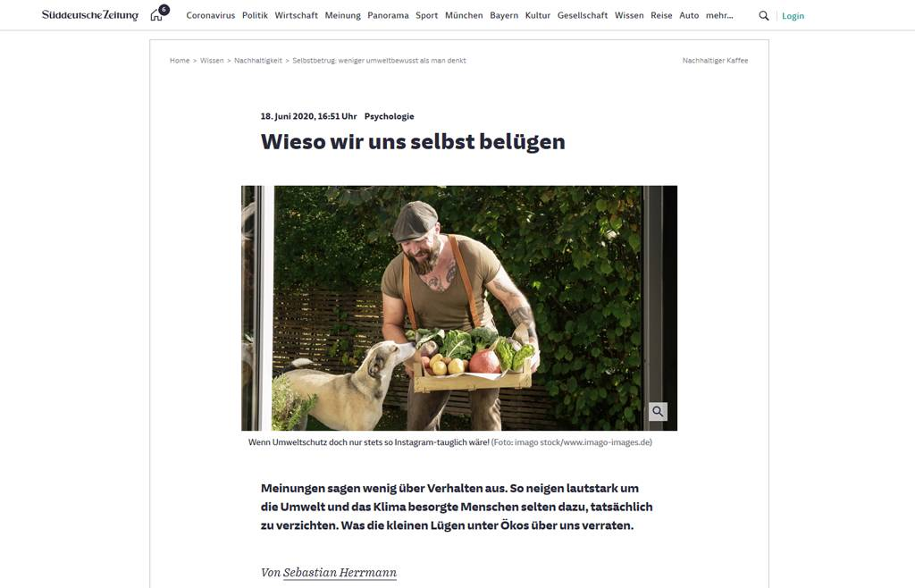 Mature man carrying crate with vegetables in his garden - REAF00385