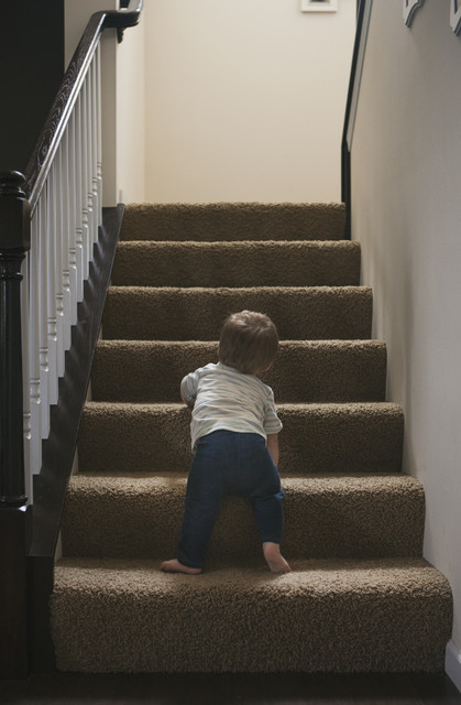 stock photo: toddler climbs stairs
