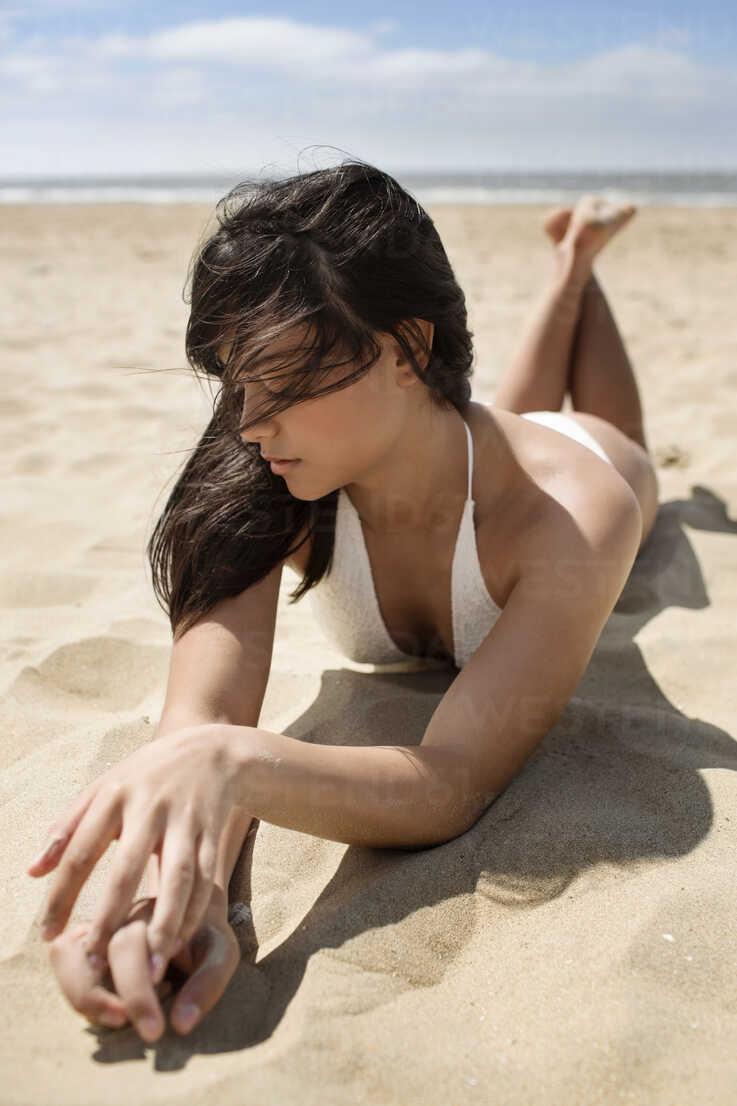 Beach woman lying on Women proudly