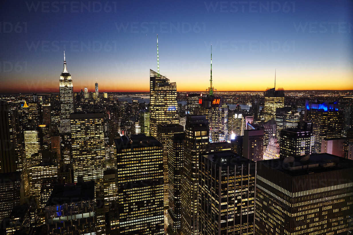 Elevated view of skyline at night with Empire State Building, New ...